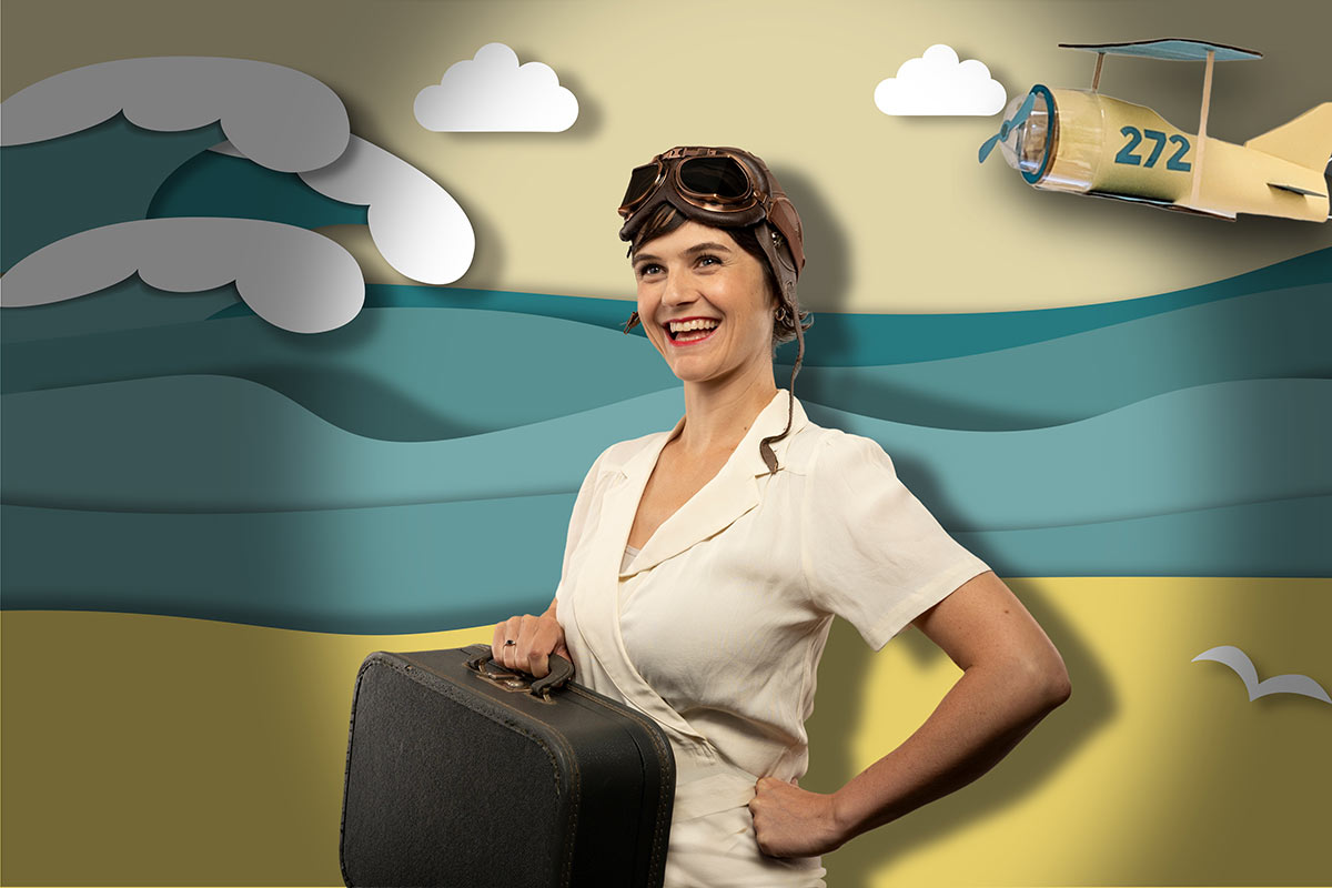 Brand photography with old-timey pilot on ocean background